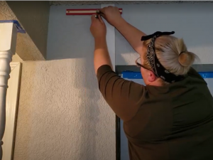 marking the wall to hang brackets