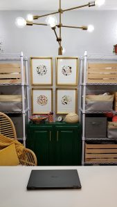 Chandelier above cabinet