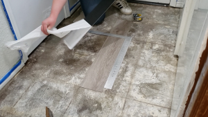 how-to-install-peel-and-stick-vinyl-plank-tiles-16